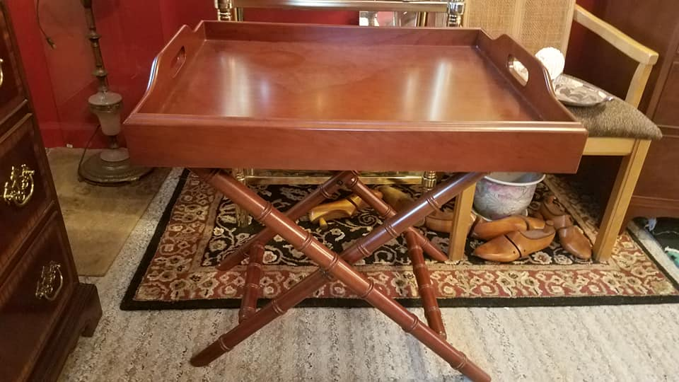 Bombay butlers table. Sturdy and solid. Tray lifts up from folding bench. Can use as bar, end table serving piece. $125