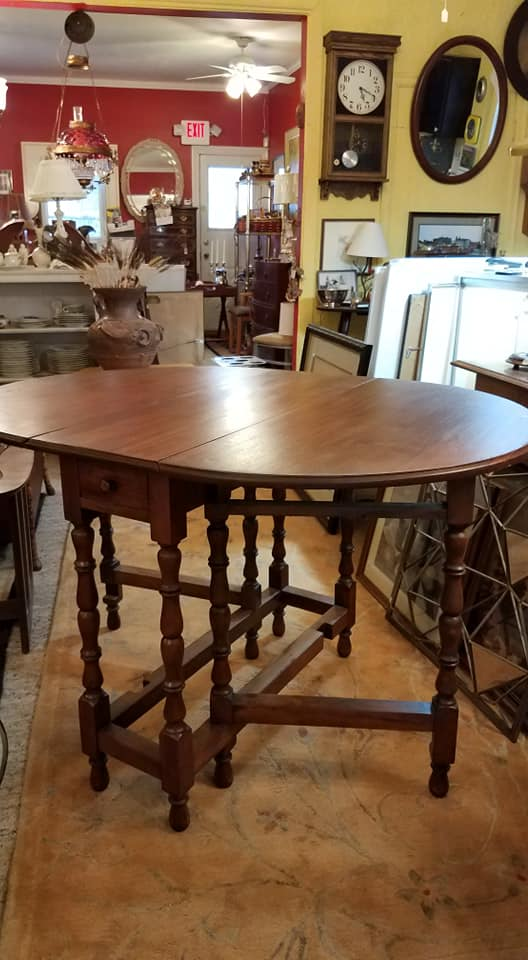 Opens into a wonderful oval table with lovely carved legs. when open 48x35--such a nice touch a drawer at the end. $175