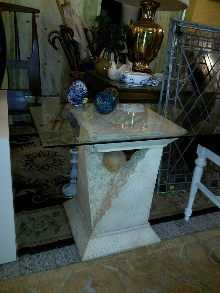 Modern table--interesting column with glass top. $40