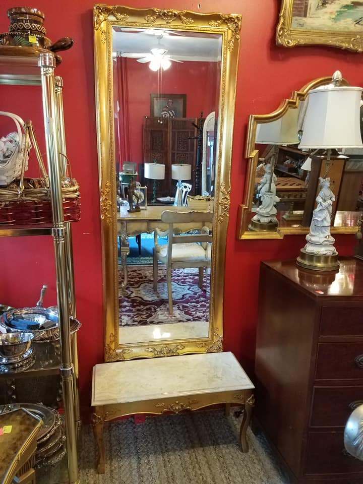 Stunning ornate gold mirror with beveled glass. Comes with wood stand with marble top. $175
